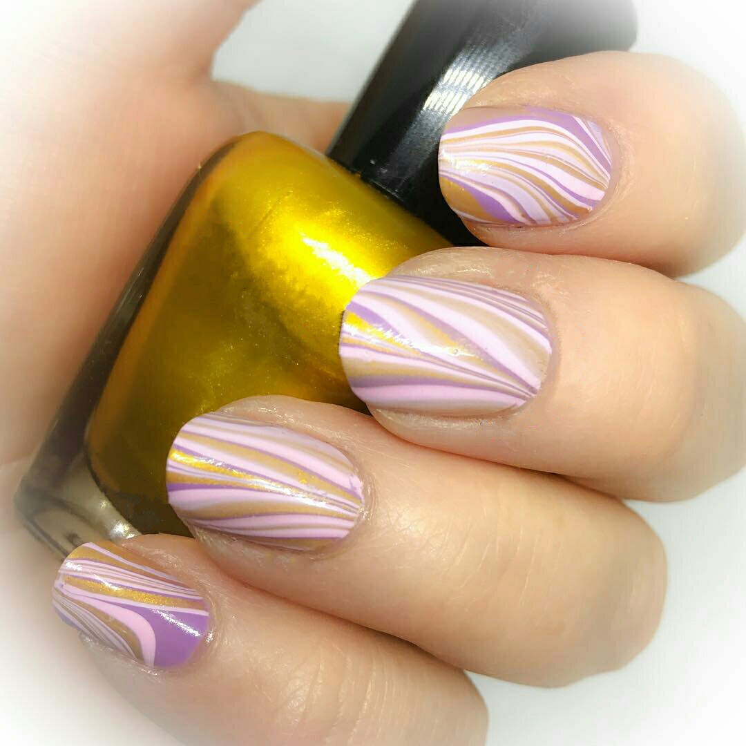 Water nail art how to do water marble nail art ladylife you need duct tape or fatty cream to remove the remains of polish from the skin around the nail also you need 3 polishes at least the transparent polish prinsesfo Choice Image