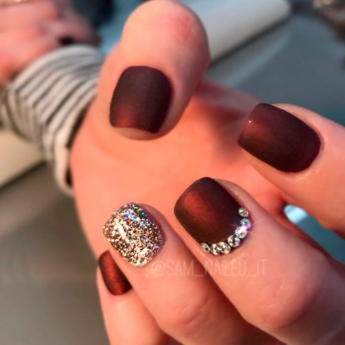 Paint all of your nails a dark matte color, like this sleek burgundy matte  polish, and then paint your ring finger with a stunning gold glitter polish. - Nail Designs For Short Nails 2018: 25 Cute Short Nail Designs Ideas